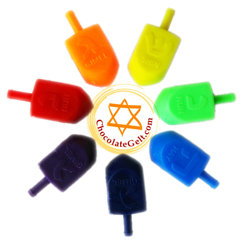Plastic dreidels and wooden dreidels for Hanukkah.