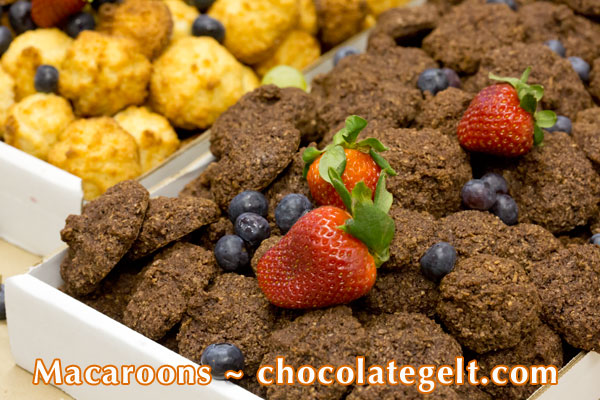 "Passover chocolate macaroons in bulk made of coconut at a local kosher bakery"" border="